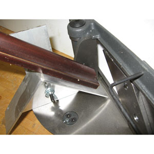 Top Trim Attachment shown installed on left side of miter trimmer 168036