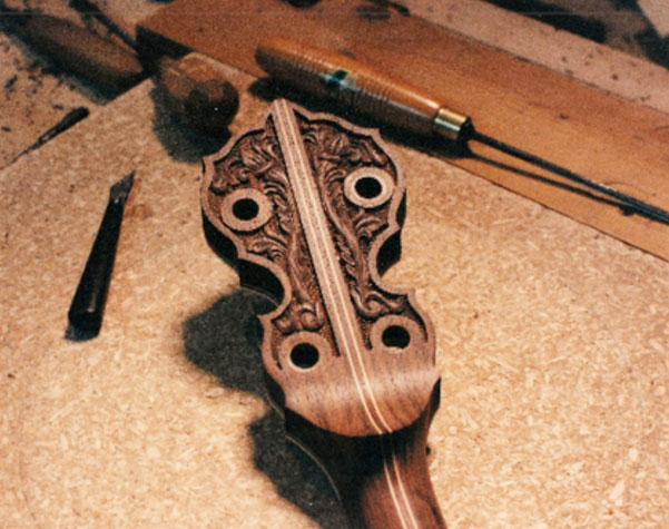 ... and the neck, carved on both the peg head and the heel. For information on these models, contact OME Banjo. The resonator above is walnut.
