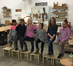 Kids in the woodworking shop